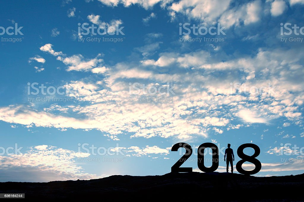 2018, silhouette of a man standing in the sun stock photo