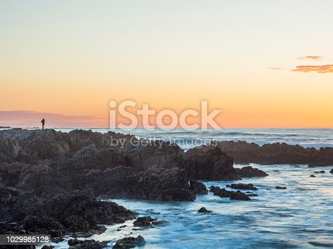 silhouette of a man standing on rock formation,California,USA.