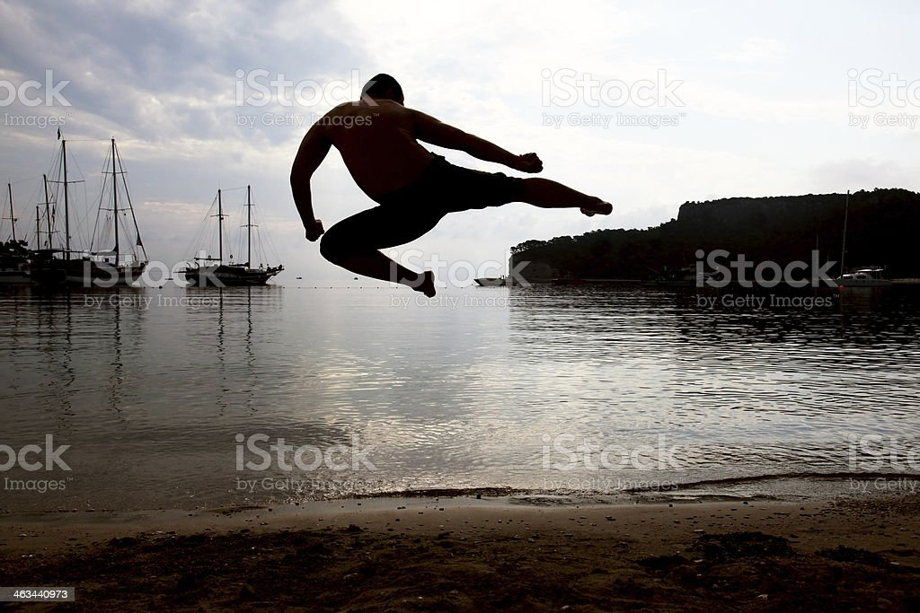 Silhouette of a man who exercise stock photo