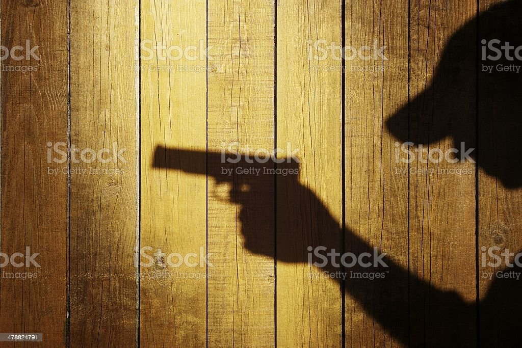 Silhouette of a man with a handgun, XXXL image stock photo