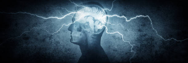 Silhouette of a man's head with x-rayed head and lightning coming out of the brain. stock photo