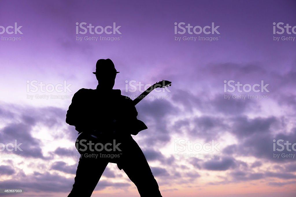 Silhouette of a Musician royalty-free stock photo