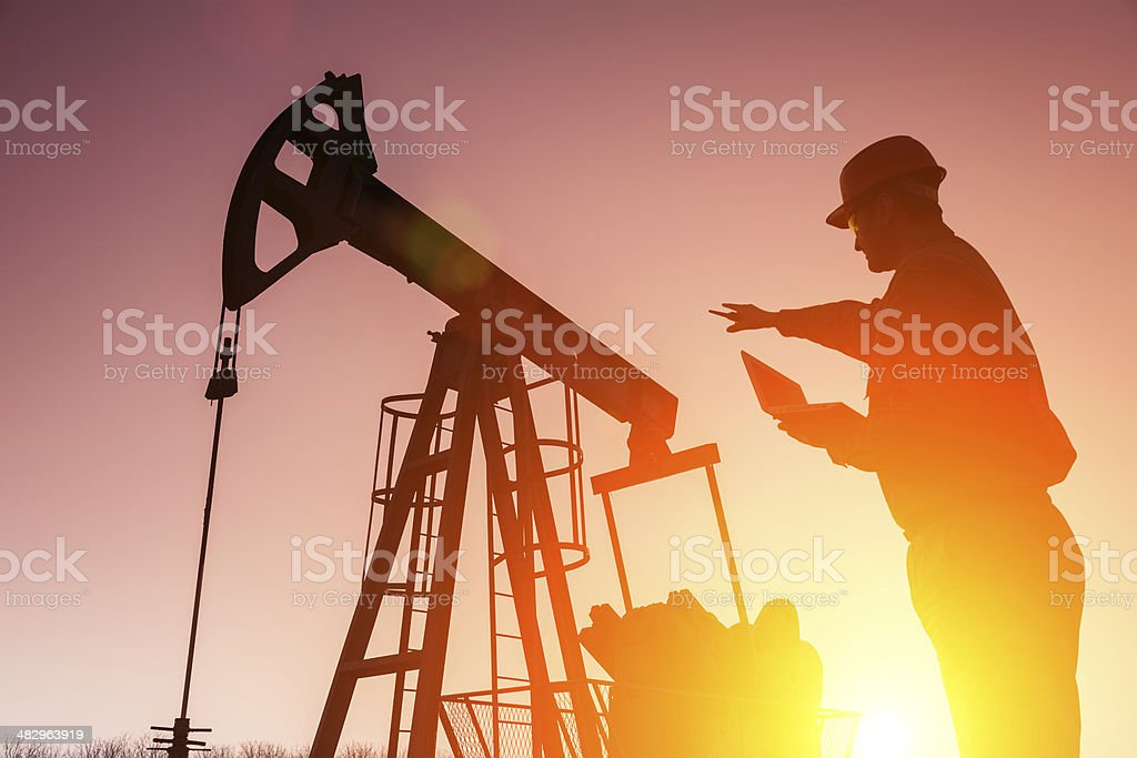 Silhouette of a oil drill worker royalty-free stock photo