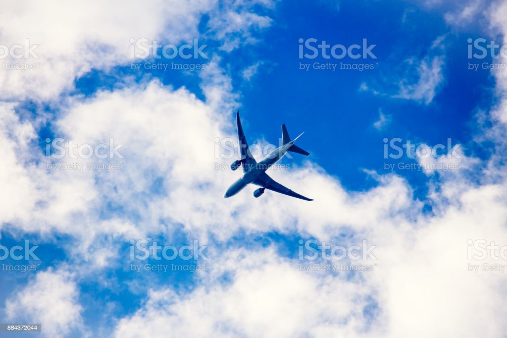 Silhouette of a passenger aircraft against a blue sky stock photo