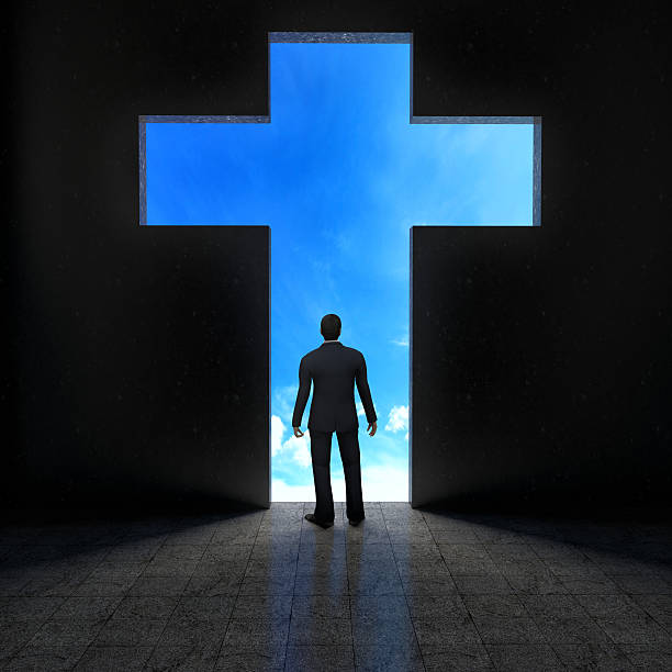 Silhouette of a person before a symbol of faith Silhouette of a person before a symbol of faith revival stock pictures, royalty-free photos & images