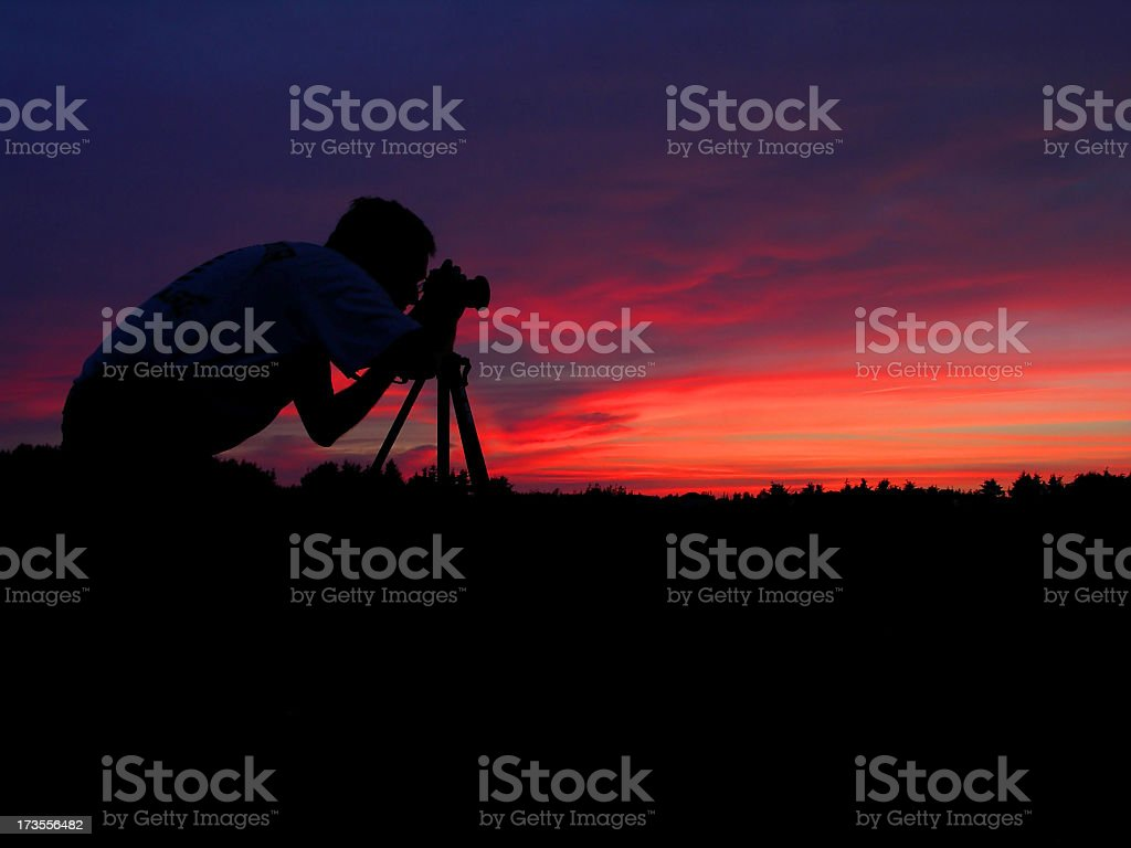Silhouette of a photographer at the sunset royalty-free stock photo