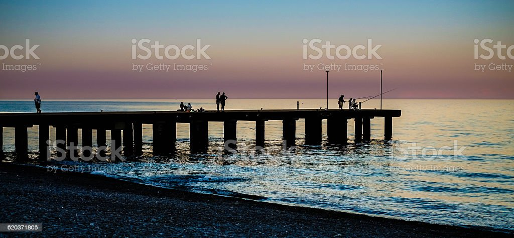 Silhouette of a pier at sunset on the Ionian sea foto de stock royalty-free