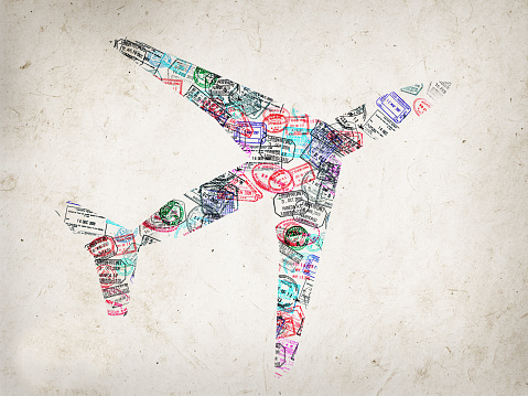 Silhouette of a plane created with passport stamps on textured background, travel concept