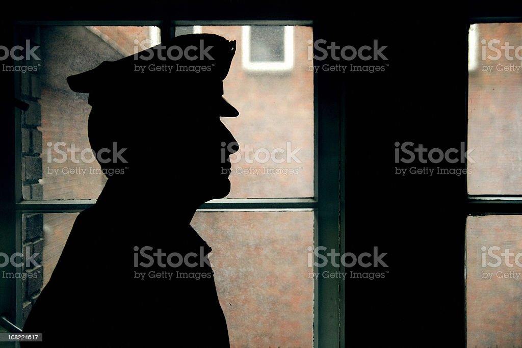 Silhouette of a prison/police warden stock photo