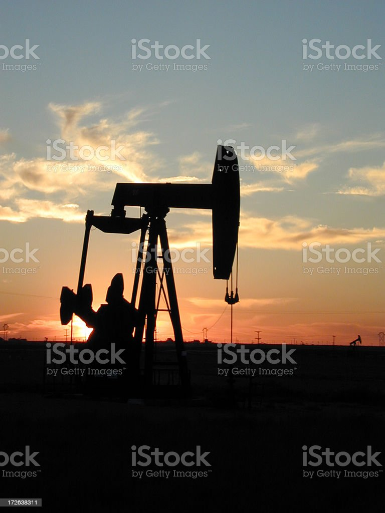 A silhouette of a pump jack in Texas royalty-free stock photo