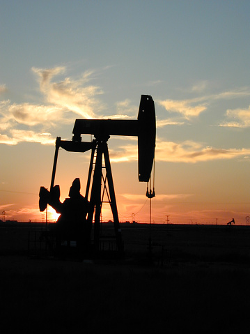 A silhouette of a pump jack in Texas