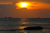 A silhouette of a rock on Ba Keo Beach at sunset on the tropical island, Phu Quoc, Vietnam