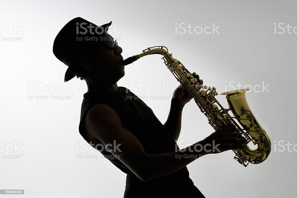 Silhouette of a Saxophonist stock photo