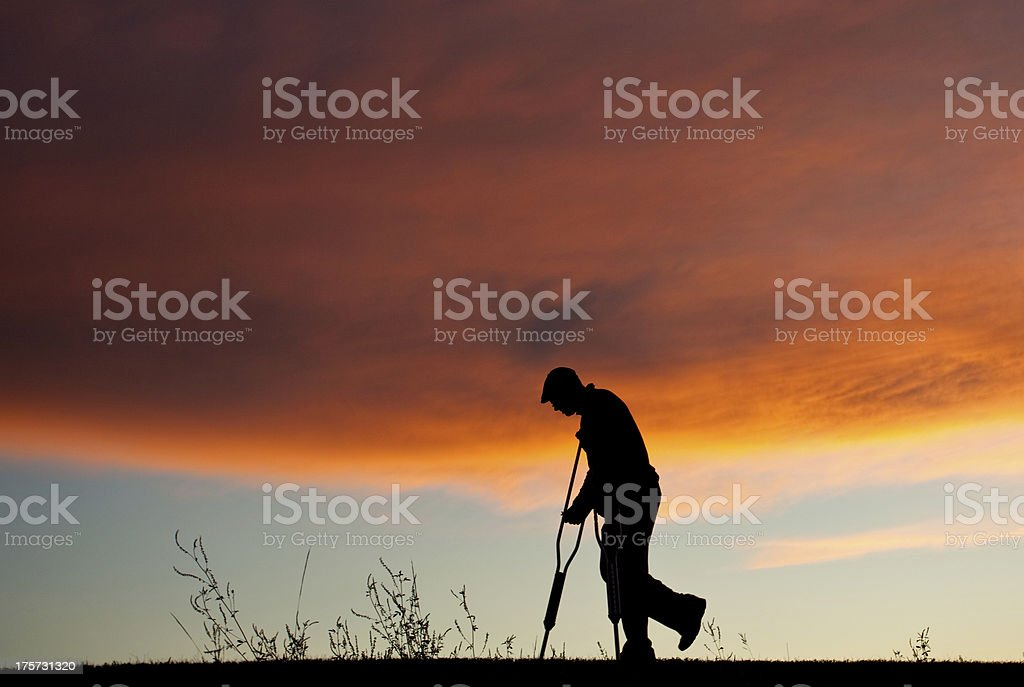 Silhouette of a Senior Man With Crutches royalty-free stock photo