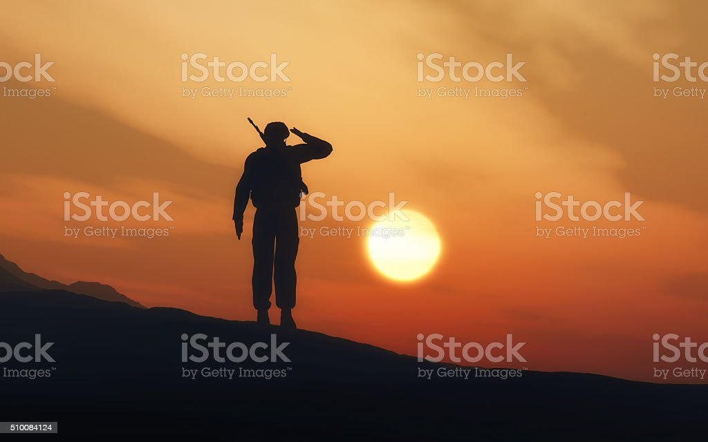Silhouette of a soldier saluting stock photo