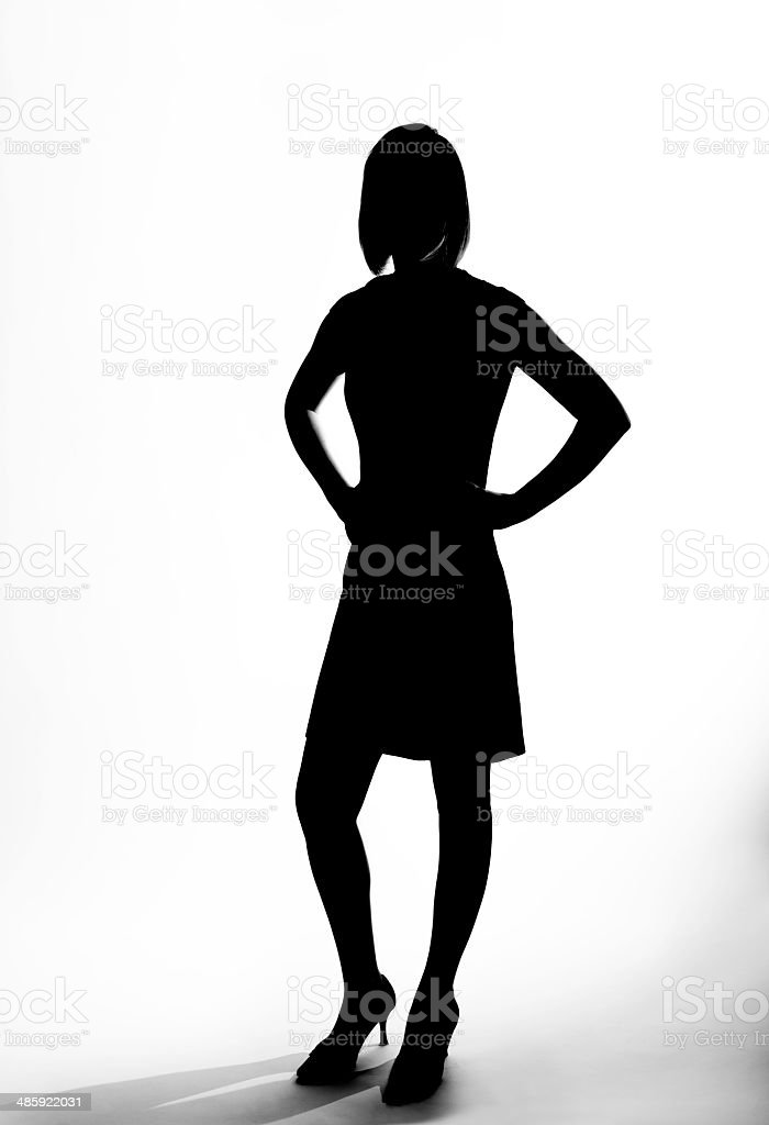 Silhouette of a sophisticated woman stock photo