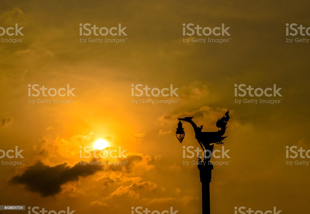 Silhouette of a Statue of a Swan. stock photo