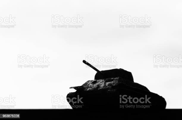 Silhouette of a tank against a background of dark clouds sky. The concept of war of the army of political conflict