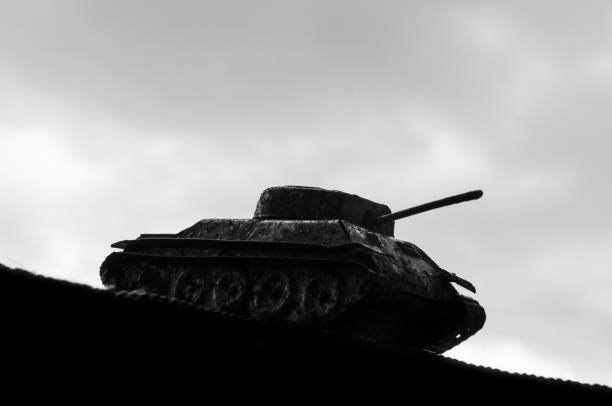 Silhouette of a tank against a background of dark clouds sky. The Second World War. 1939-1945. 9-th of May. Great Victory Day. The concept of war of the army of political conflict - foto stock