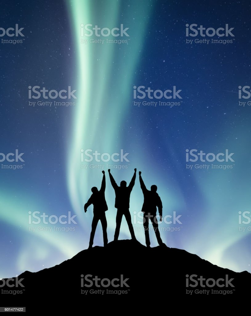 Silhouette of a team on the northen light backgroun. Concept and idea of active life stock photo