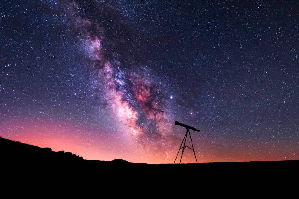 silhouette of a telescope at the starry night and bright milky way galaxy. - astronomy stock pictures, royalty-free photos & images