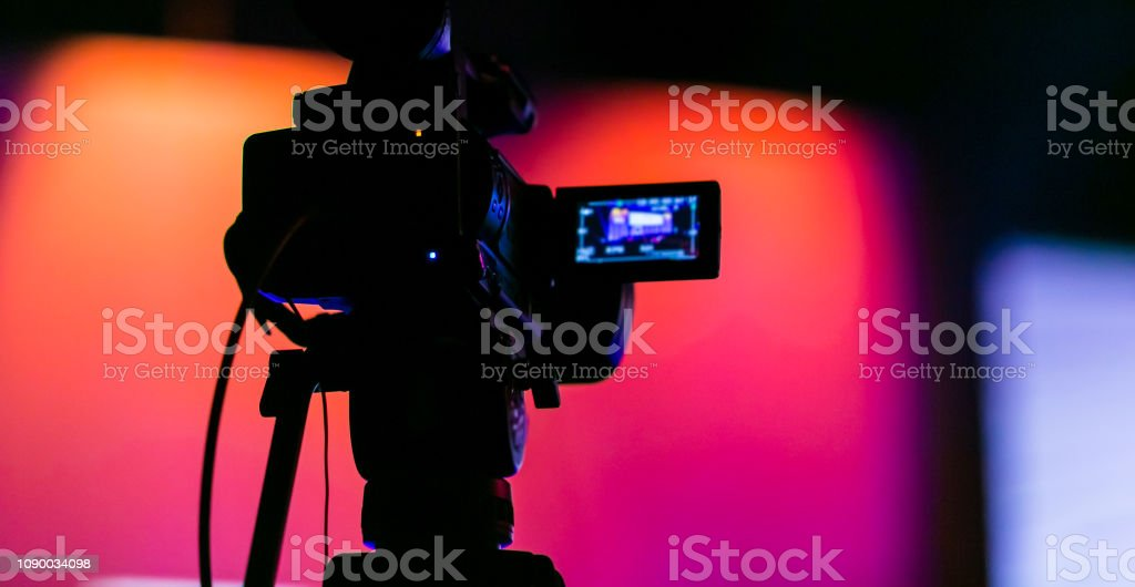 Silhouette of a TV Camera filming a live broadcast stock photo
