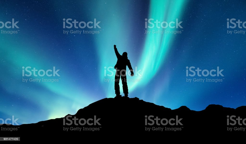 Silhouette of a winner on the northen light backgroun. Concept and idea of active life stock photo