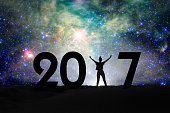 2017, silhouette of a woman and starry night, 2017 new year concept - NASA elements are included