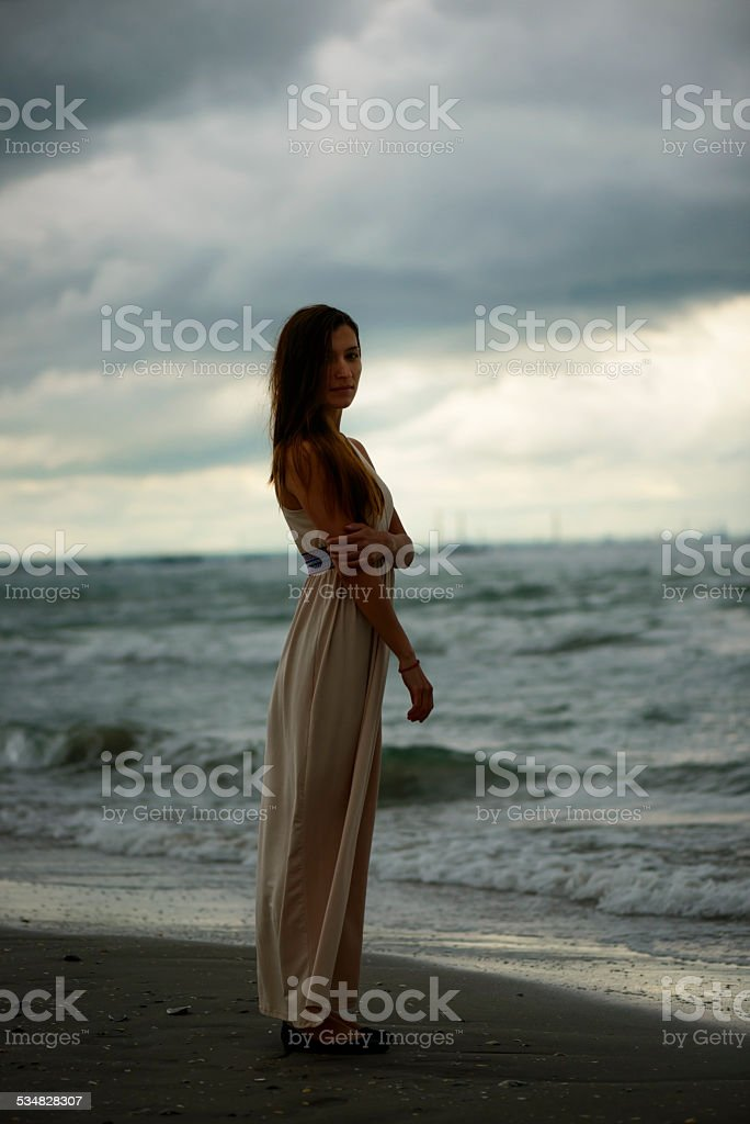 Silhouette of a woman at dawn stock photo