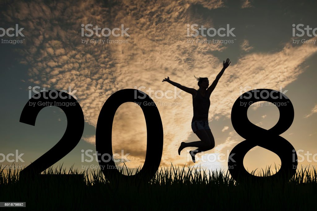 Silhouette of a woman jumping in 2018 on the hill at sunset stock photo
