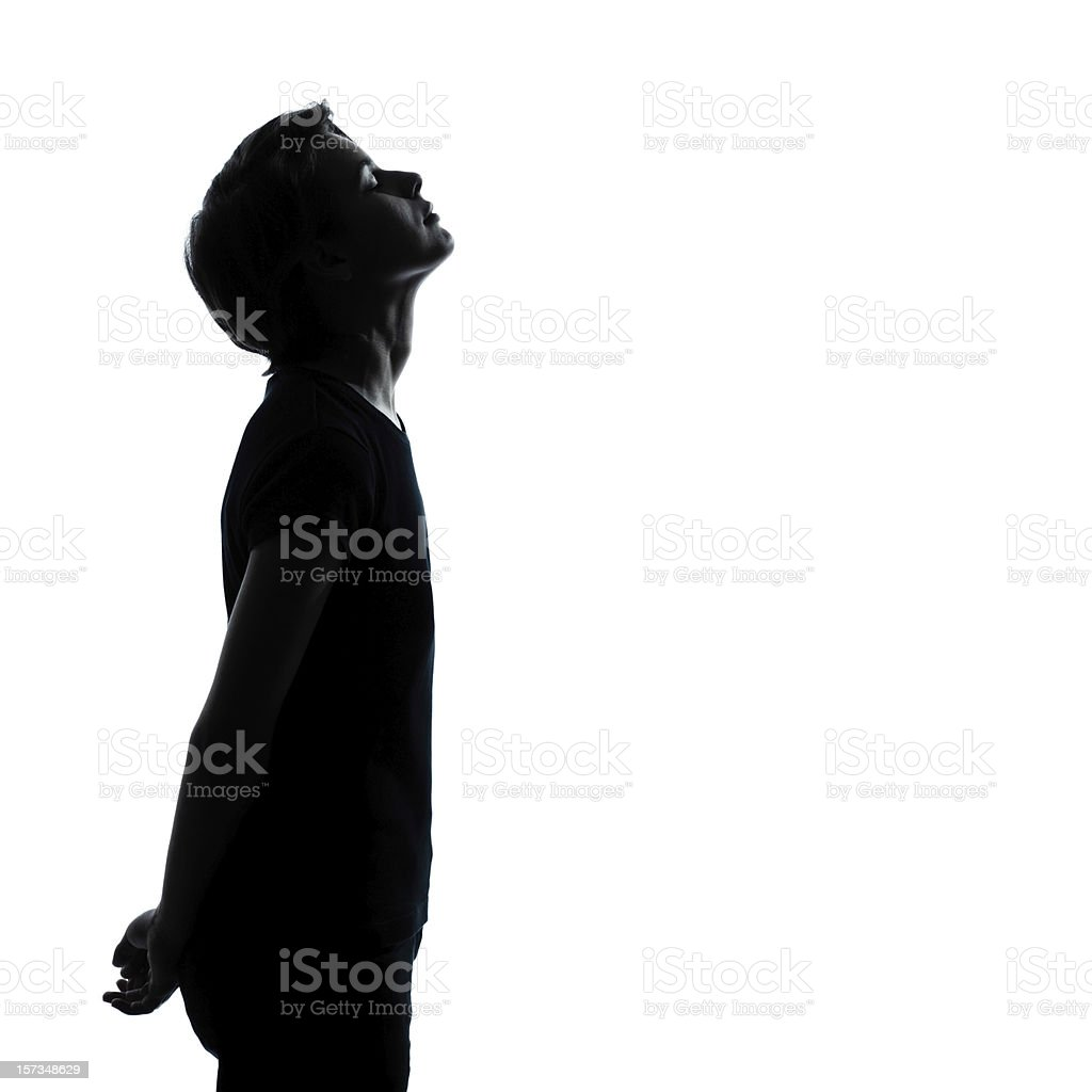 A silhouette of a woman looking up to the sky stock photo