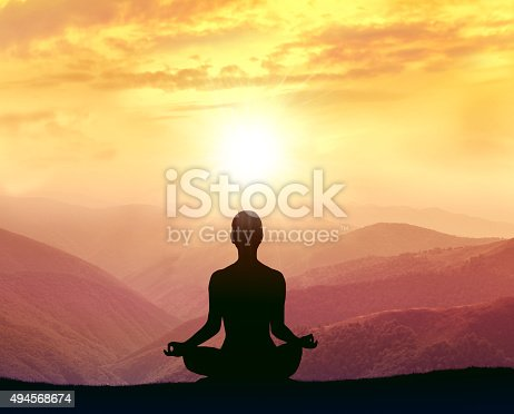 istock Silhouette of a woman practicing yoga in the mountains 494568674