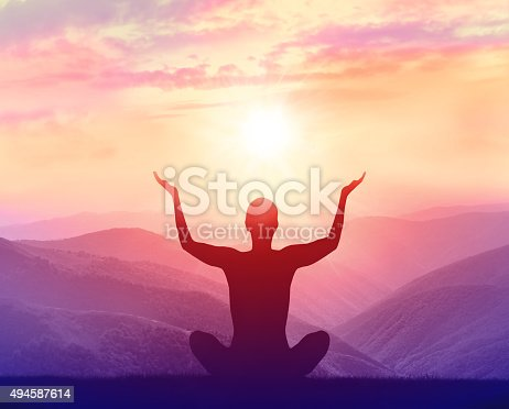 istock Silhouette of a woman practicing yoga in the mountains 494587614