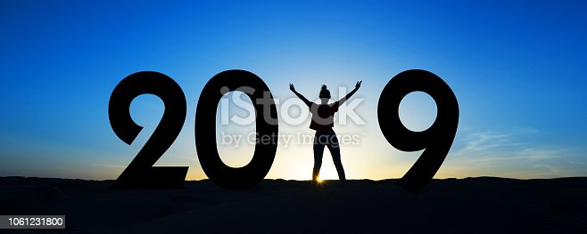 istock 2019, silhouette of a woman standing in the sun, blue sky 1061231800
