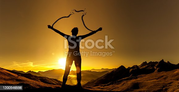 Silhouette of a woman with broken chains
