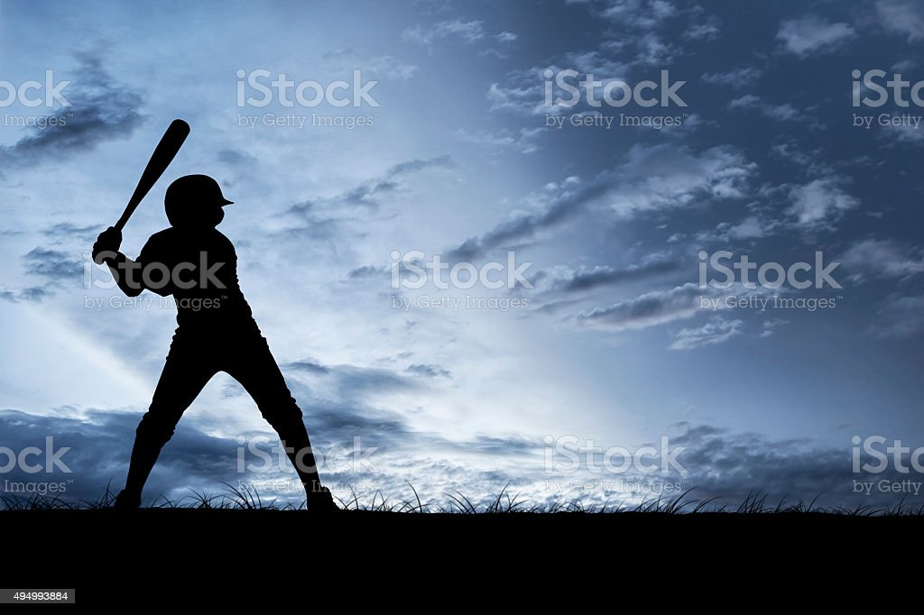 Silhouette of a Young Baseball Player stock photo
