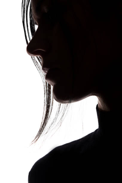 Silhouette of a young woman in sorrow stock photo