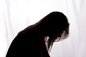 istock Silhouette of a young woman with problems 1132848597