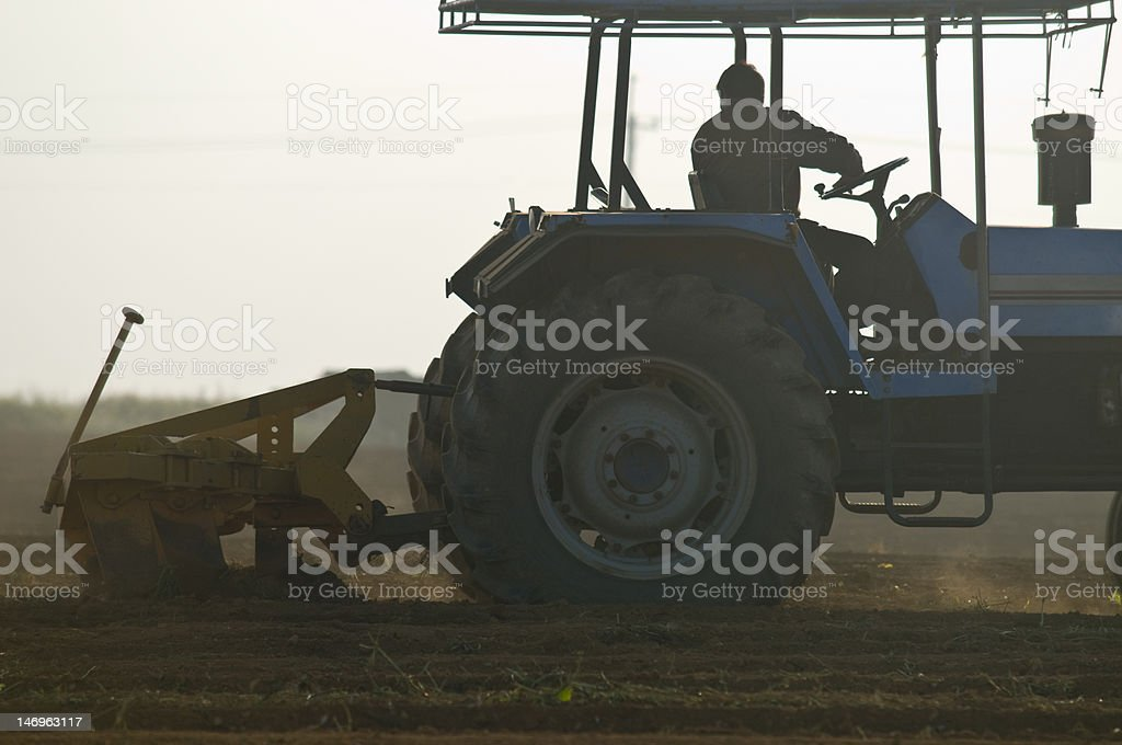 Silhouette of agriculture tractor royalty-free stock photo