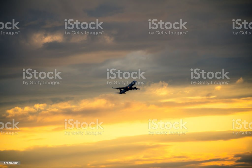 Silhouette of airplane at sunset royalty-free stock photo