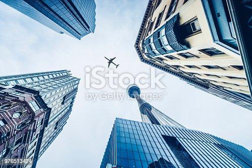 silhouette of airplane flying over Sydney CBD,Australia.