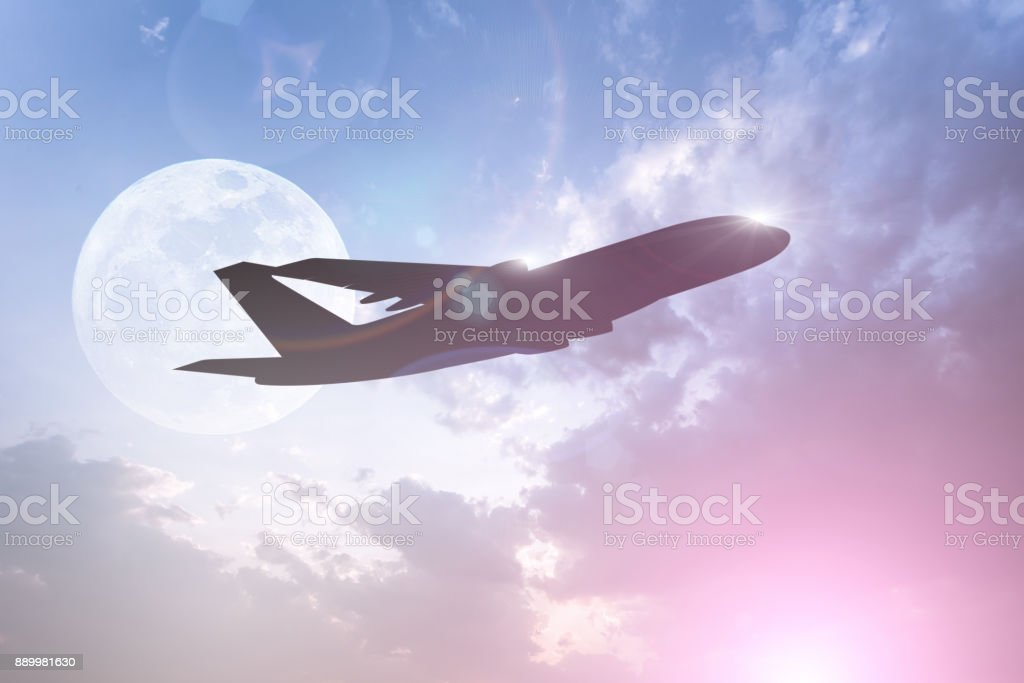 Silhouette of Airplane take off on the Colorful dramatic sky with cloud at full moon background stock photo