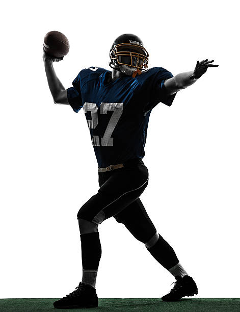 Silhouette of American quarterback throwing football one caucasian quarterback american throwing football player man in silhouette studio on white background quarterback stock pictures, royalty-free photos & images