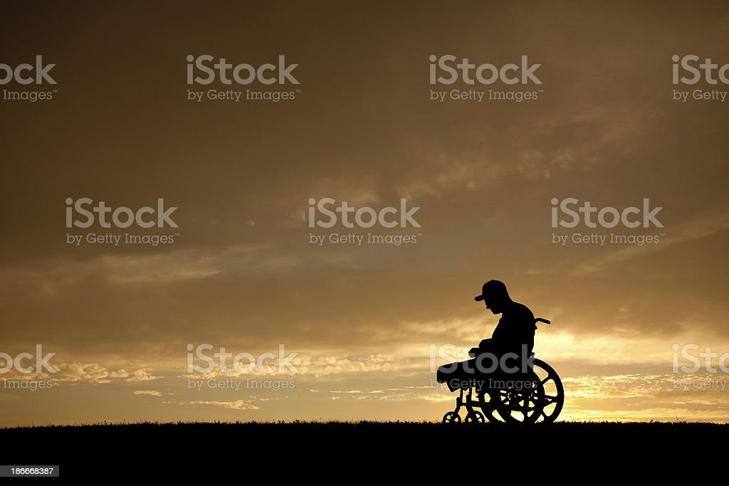 Silhouette of an Amputee In A Wheelchair stock photo