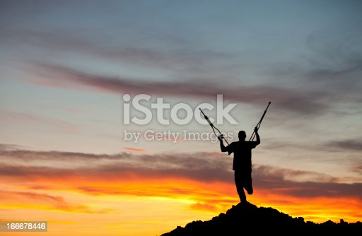 istock Silhouette of an Amputee With Crutches Raised 166678446