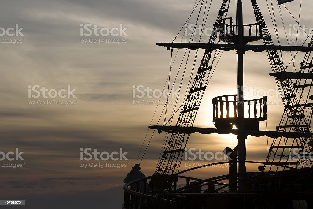 Silhouette  of an antique ship stock photo