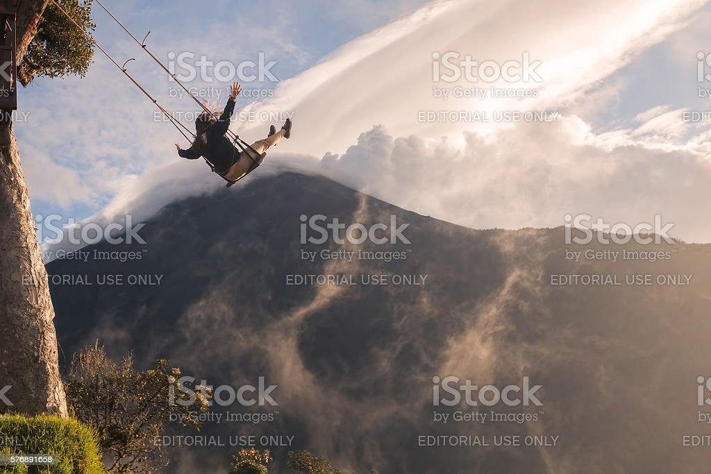 Silhouette Of An Happy Woman On A Swing stock photo
