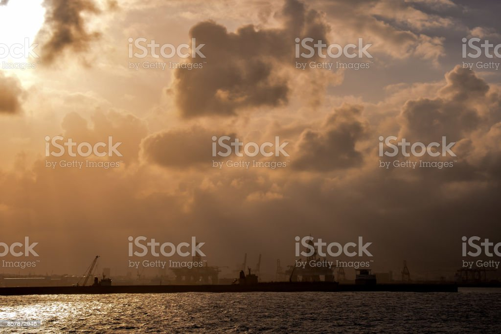 Silhouette of an offshore drilling rig stock photo