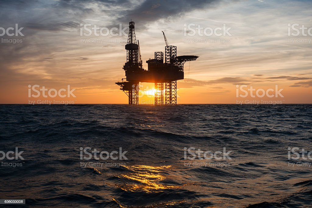 Silhouette of an offshore oil drilling rig stock photo