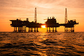 Silhouette of an offshore oil installation